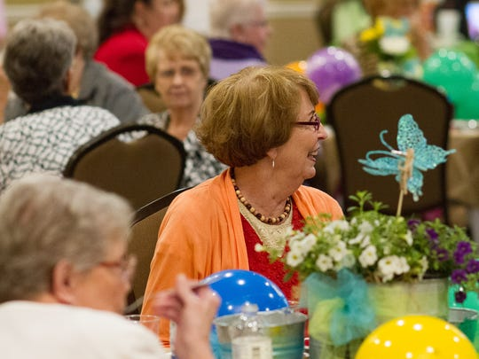 Women gathered for the Blossoming Into a Better You Women's Conference fashion show Thursday at the Carl Grant Events Center at Union University.