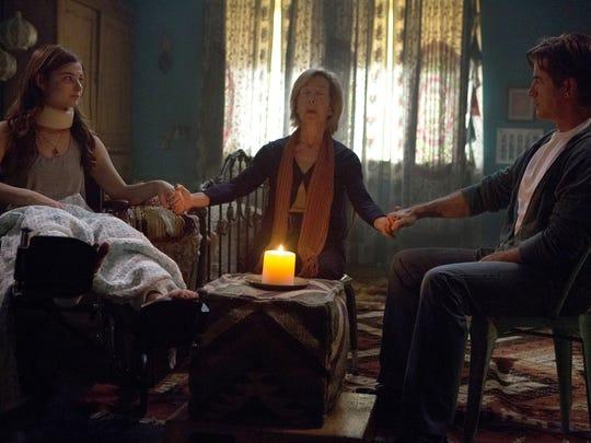 "Stefanie Scott, left, Lin Shaye and Dermot Mulroney in ""Insidious: Chapter 3."""