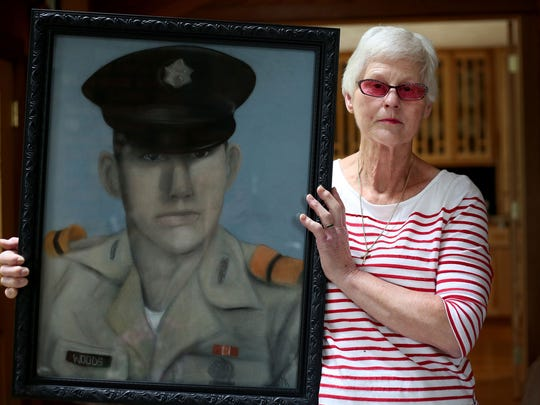 Yvonne Sanders, 72, holds a chalk drawing of her brother Gerald Woods in her Silverton home on Thursday, May 21. Woods' remains were never returned to the family after his helicopter went down during the Vietnam War.