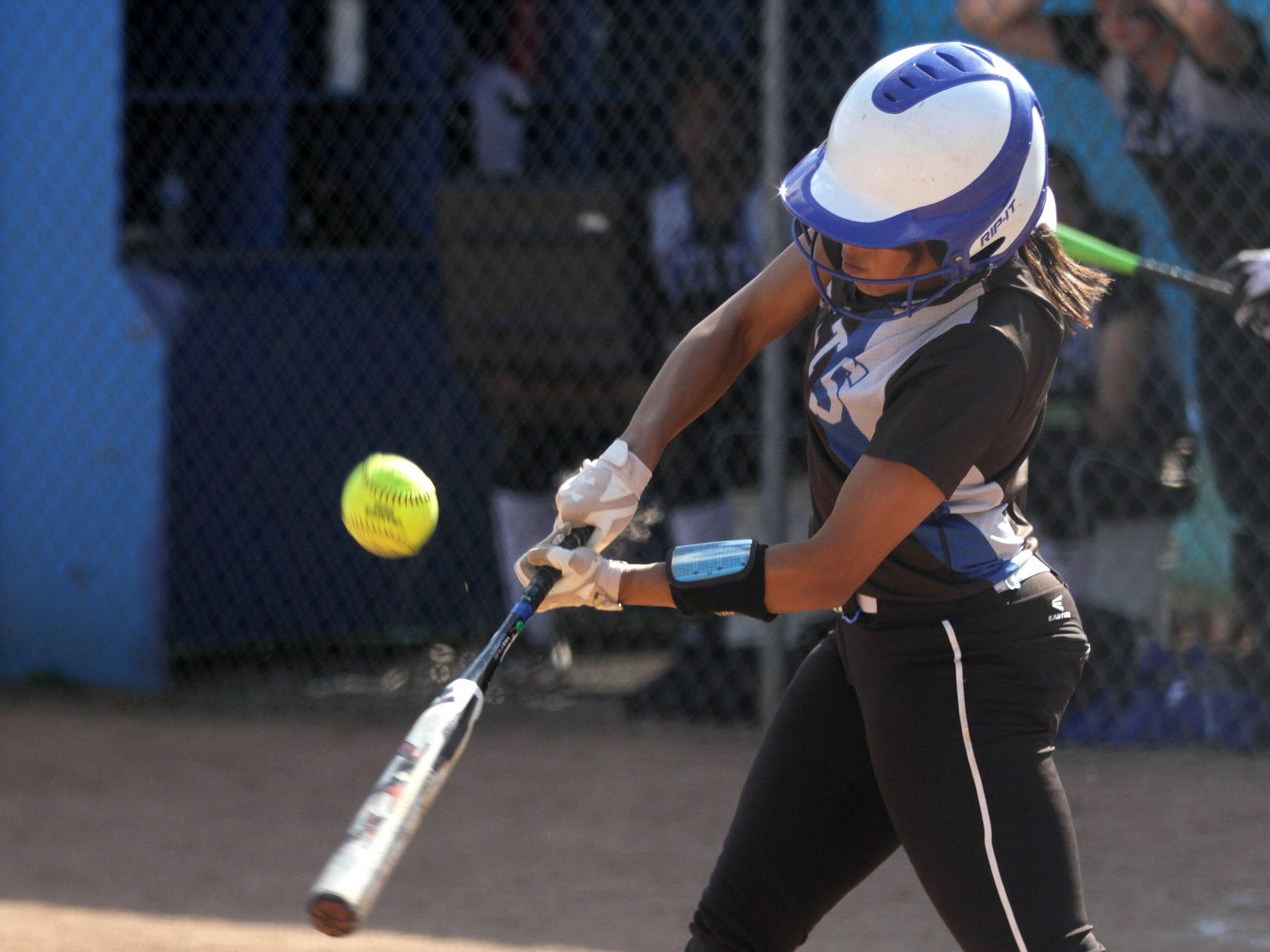 McNary's Kimi Ito (1) bats in the Gresham vs. McNary softball game, in the first round of the OSAA class 6A state playoffs, at McNary High School in Keizer on Monday, May 25, 2015. McNary won the game 11-7.