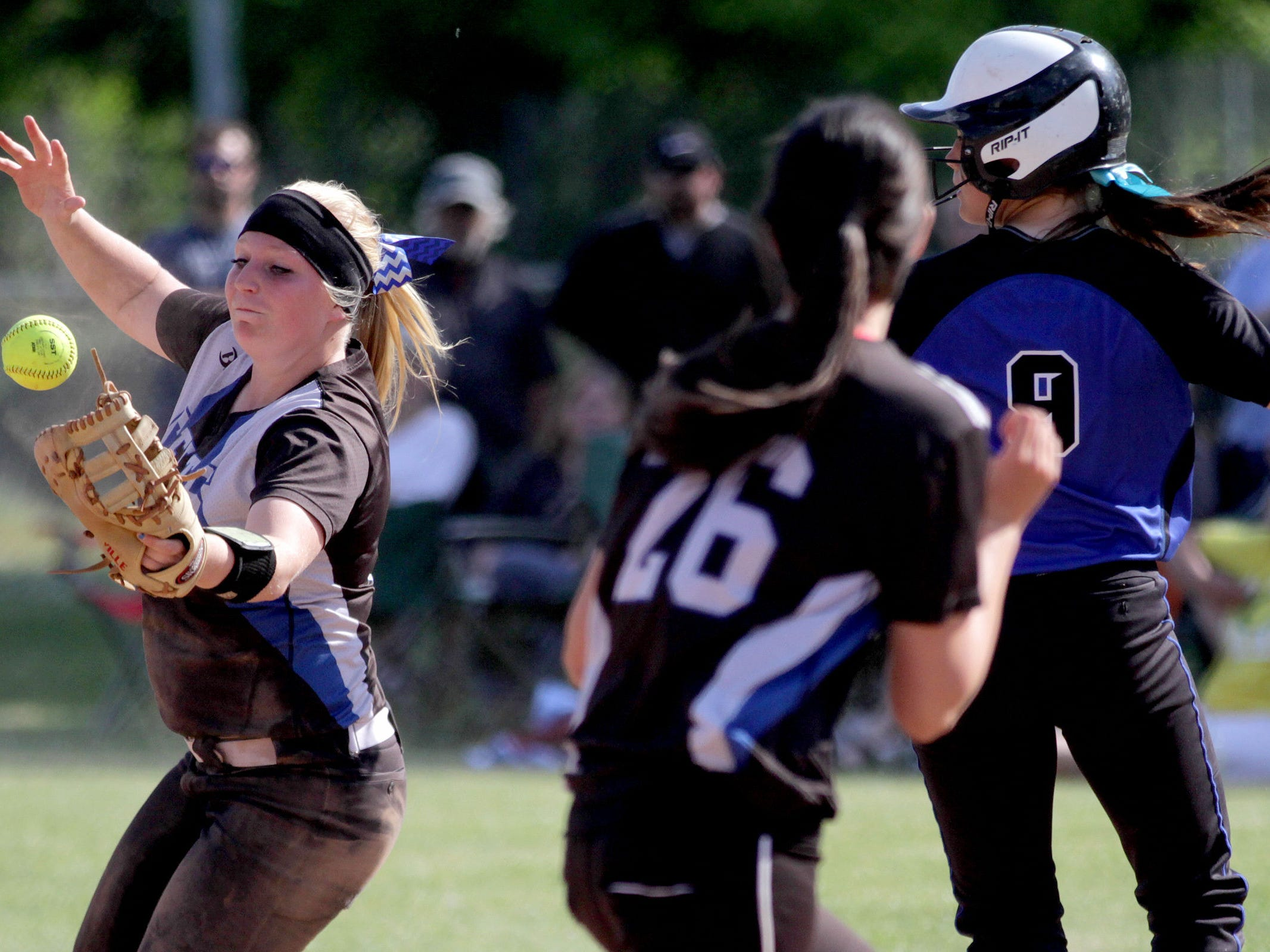 McNary's Madisen Oliver (3) tries to take Gresham's Erika Espinoza (9) out at first in the Gresham vs. McNary softball game, in the first round of the OSAA class 6A state playoffs, at McNary High School in Keizer on Monday, May 25, 2015. McNary won the game 11-7.