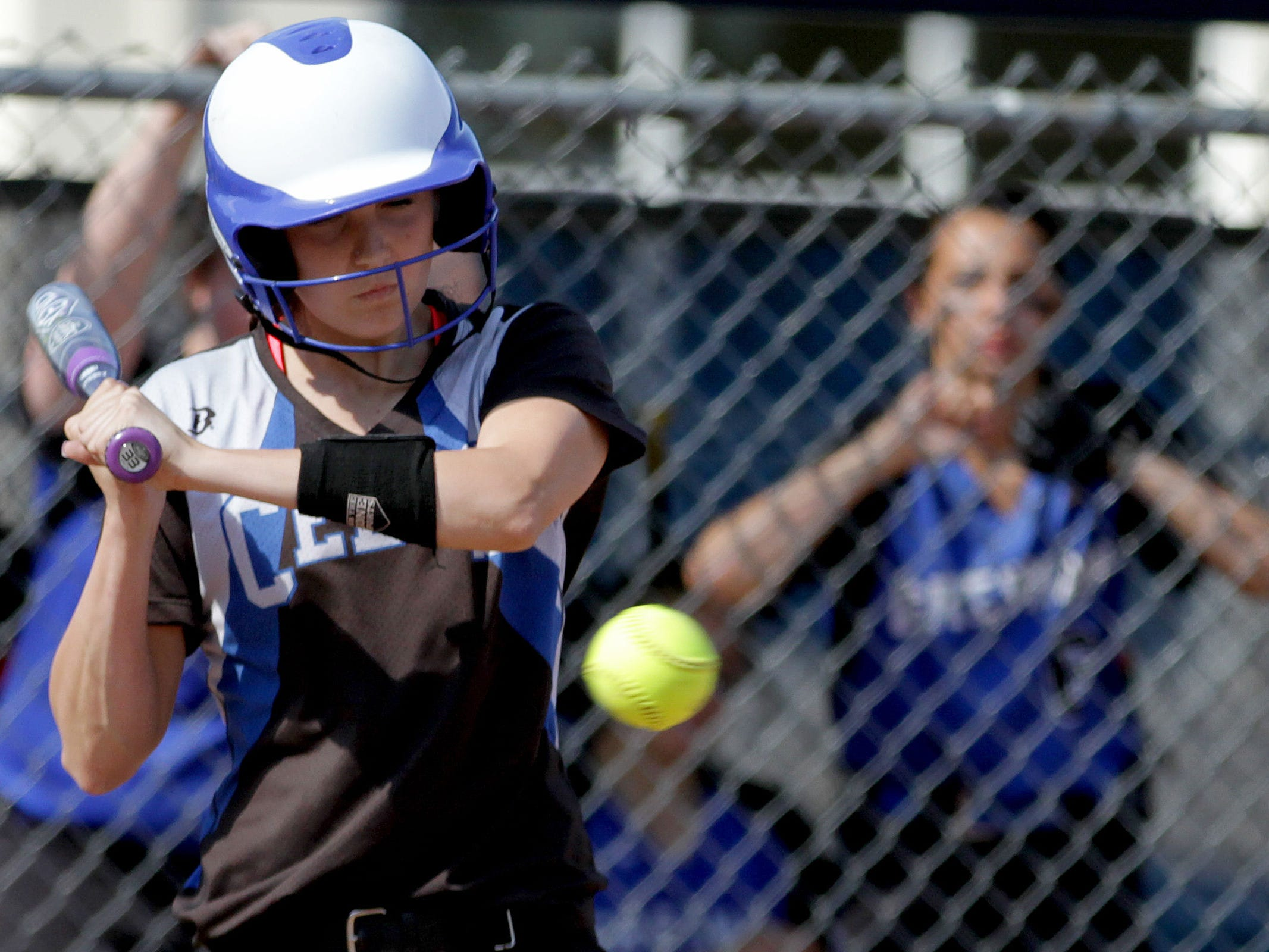 McNary's Megan Ulrey (26) bats in the Gresham vs. McNary softball game, in the first round of the OSAA class 6A state playoffs, at McNary High School in Keizer on Monday, May 25, 2015. McNary won the game 11-7.