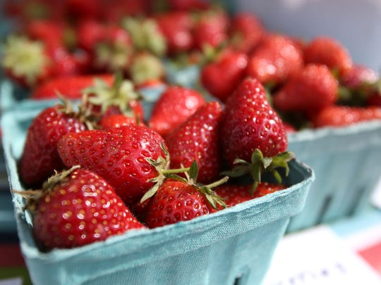 Fresh strawberries at Backyard Bounty were for sale at The Original Independence Farmers Market on Saturday, May 30, 2015, in Independence, Oregon.