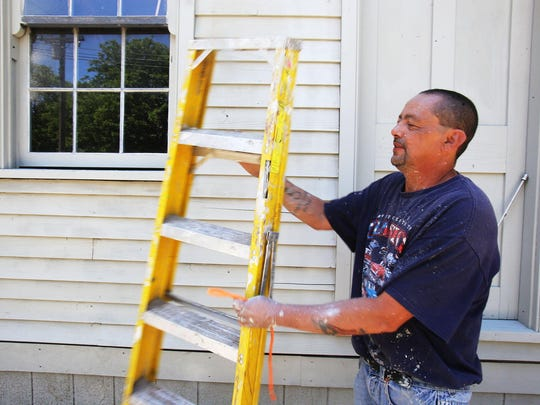 Volunteers like Hector Gomez, of Detroit put the finishing
