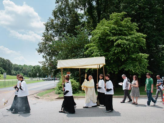 The processional for the Feast of Corpus Christi is held at St. Mary's.