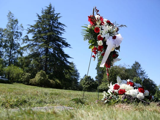 A burial service for Travis Lane, who was killed while walking home by a driver charged with DUI, was held at Belcrest Memorial Park on Monday, June 8, 2015, in Salem, Ore.