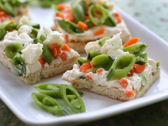 Lighten up your summer appetizers with Veggie and Cream Cheese Ranch Squares with Crescent Roll Crust.