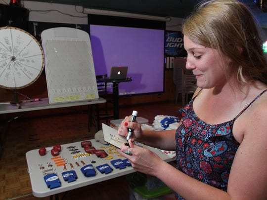 """Megan Cuttrell of South Belmar prepares for a game of """"Price is Wrong"""" at PK's Shamrock Pub lin Lake Como. The restaurant and bar is known around town for its games, which also include Sunday bingo."""