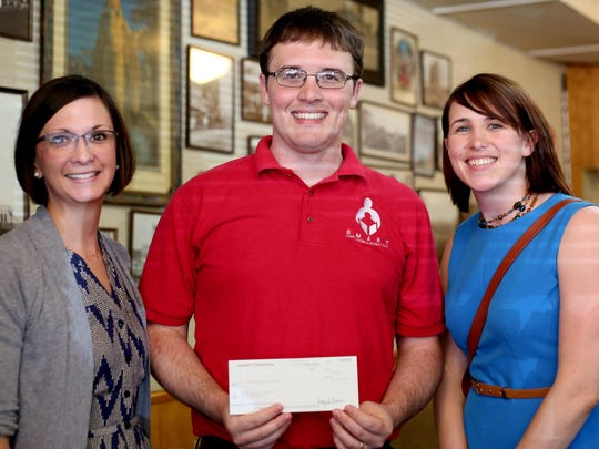 MiKayla Ryan (from left), Michael Finlay and Jenn Columbus, with S.M.A.R.T., accept a Gannett grant, at the Statesman Journal's Holding Court at the Court Street Dairy Lunch in downtown Salem on Tuesday, June 16, 2015.
