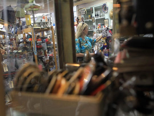 Sherry Pardee of Iowa City browses Artifacts on Friday. The store will celebrate 20 years in business on Saturday.