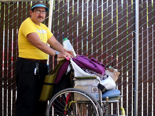 "Michael Hancock, 32, has been homeless in Salem since October 2014. He has to push his belongings along with him as he walks in the summer heat. ""I get so burnt out that I try to lay down and read, but I can't even do that,"" Hancock said. ""I can't rest."" Photographed at the Northwest Human Services Homeless Outreach & Advocacy Program (HOAP) center in Salem on Friday, June 12, 2015."