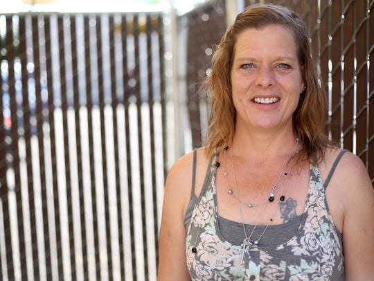 "Tami Partlow, 49, has been homeless in Salem since November 2014 after having a mental breakdown when her boyfriend suddenly died. As the summer heat gets stronger, Partlow says she fills up her water bottle from hoses and walks around the mall to try and stay cool. As she gets back into stable housing, Partlow plans on staying involved in the lives of the homeless. ""I'm going to stick around, regardless of if I'm homeless or not,"" she said. Photographed at the Northwest Human Services Homeless Outreach & Advocacy Program (HOAP) center in Salem on Friday, June 12, 2015."