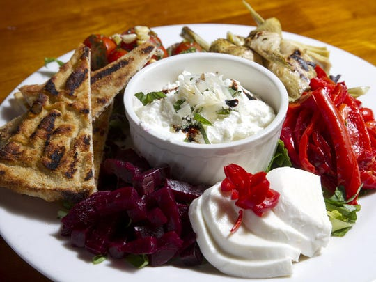 The Mediterranean platter at Front Street Trattoria in Red Bank includes grape tomatoes, olives, fresh mozzarella, artichokes, red peppers and beets with ricotta, basil and grilled focaccia.