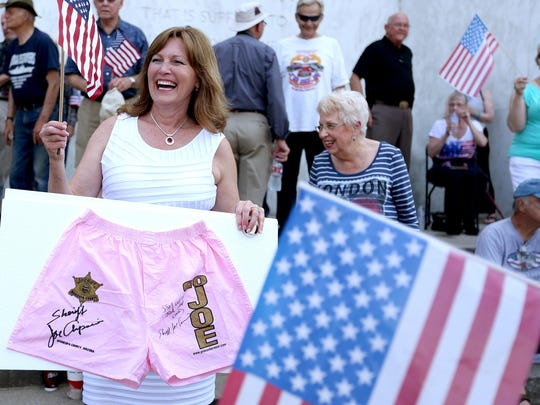 Chris Barreto, Rep. Greg Barreto's wife, carries pink underwear during a rally for Joe Arpaio, Arizona's Maricopa County Sheriff, as he speaks at the Oregon State Capitol on Saturday, June 27, 2015.