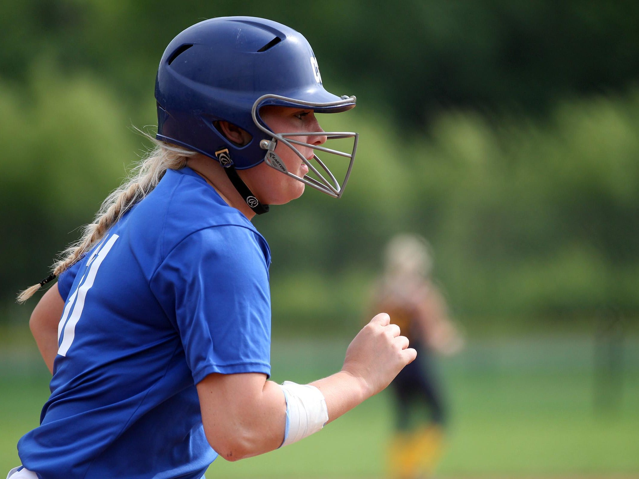 Clear Creek Amana's Lexi Kinnaird runs to first base during the Clippers' game against Regina at the University of Iowa softball complex on Friday, June 26, 2015. David Scrivner / Iowa City Press-Citizen