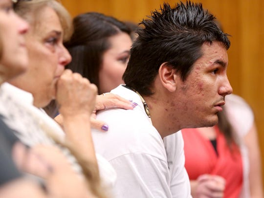 Rueben Zamora, the father of Aniya Zamora, listens during the sentencing of Mercedes Alvarado, 25, at the Marion County Courthouse in Salem on Tuesday, June 30, 2015. Alvarado was sentenced to ten years, with three years of post-prison probation for manslaughter in the 2013 death of their 3-year-old daughter, Aniya Zamora.