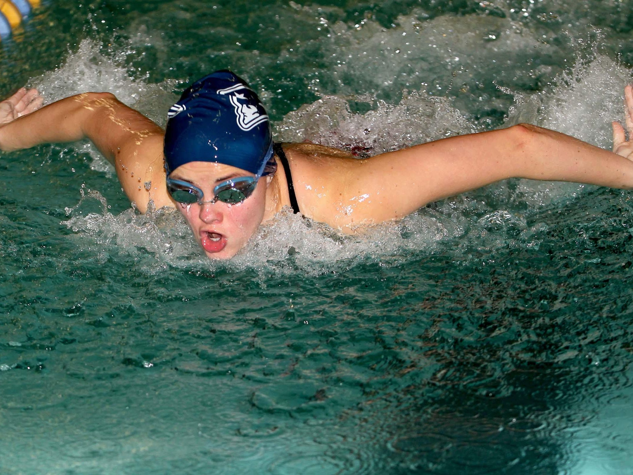 Becca Haussin of Seeger won the Wabash River Conference meet in the 100-yard butterfly.
