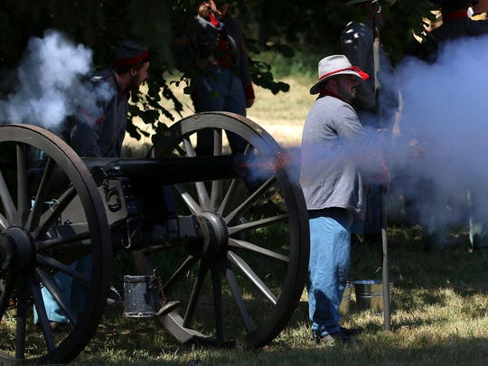Civil War reenactors with the Confederate Army fire artillery during the morning battle on Friday, July 3, 2015, at Willamette Mission State Park in Brooks, Ore.