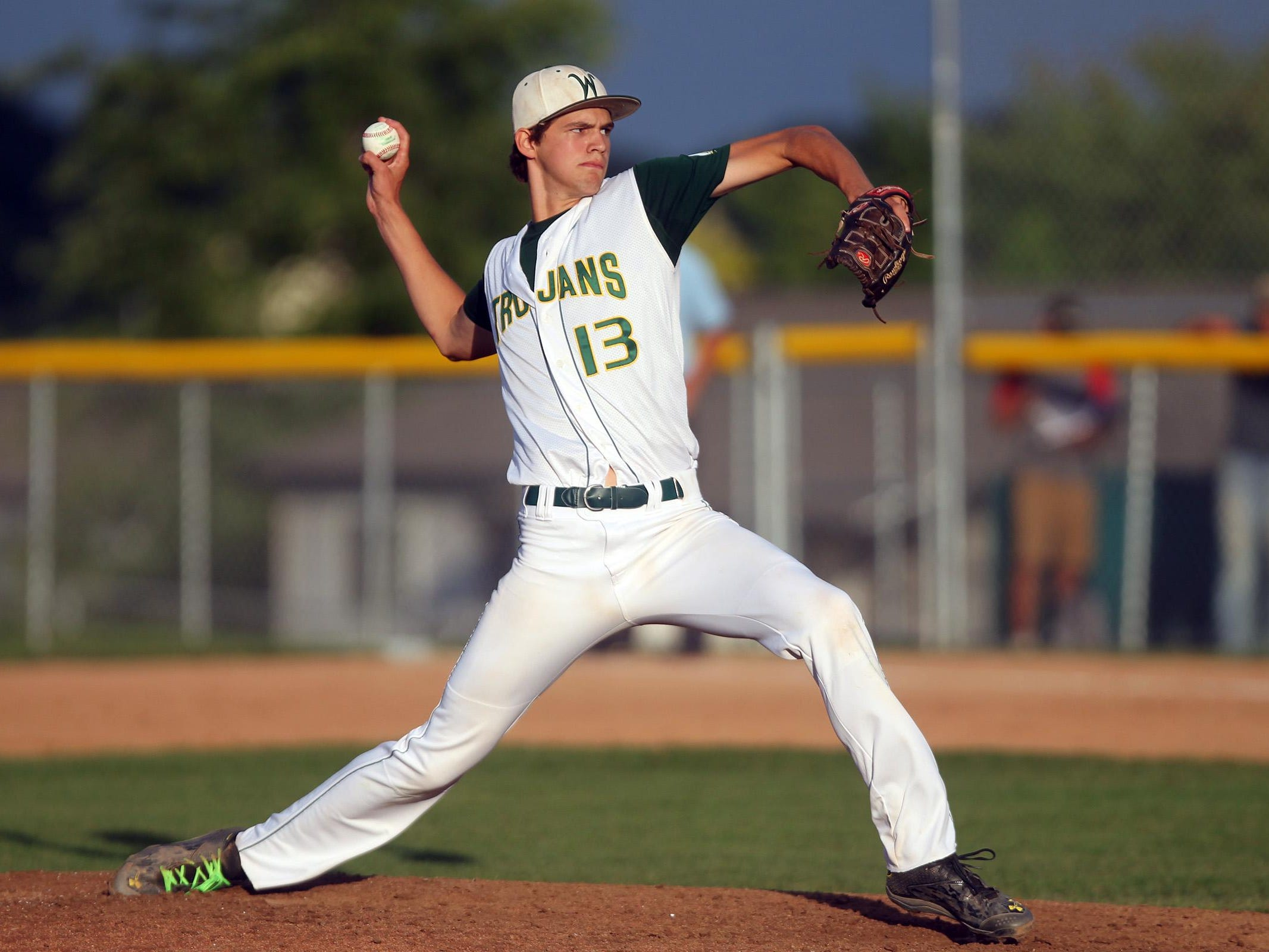 West High's Tanner Lohaus delivers a pitch during Tuesday's game. Lohaus pitched all seven innings, giving up just three hits while earning the win.