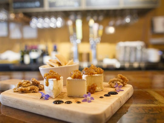 Brix's brie board, including a balsamic-peach compote, is seen on Monday, July 6, 2015. David Scrivner / Iowa City Press-Citizen