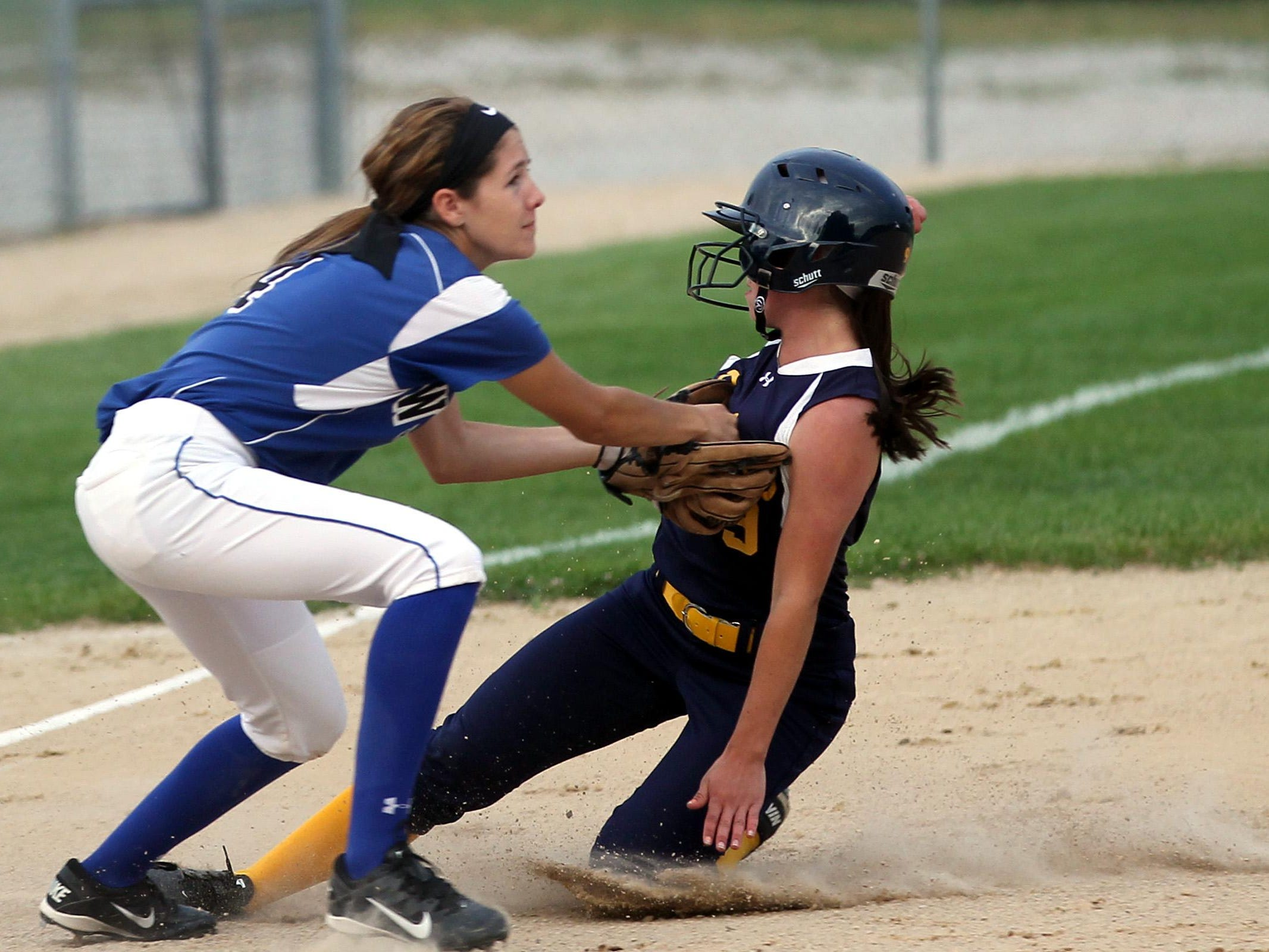 Regina's Carrigan O'Conner gets tagged out at third base during the Regals' game against Columbus on Wednesday, July 8, 2015. David Scrivner / Iowa City Press-Citizen