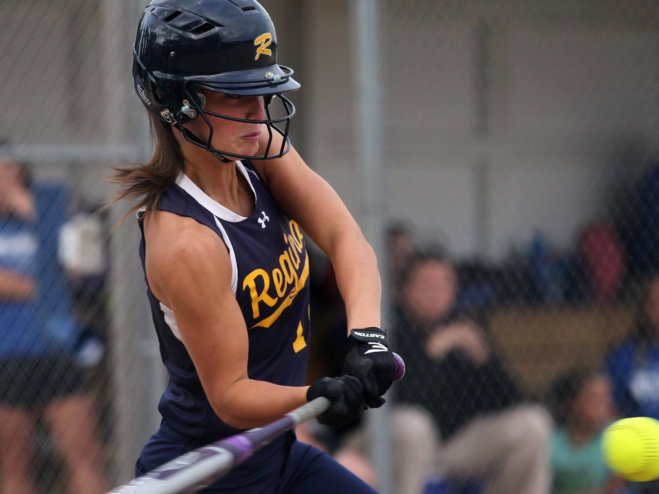 Regina's Cammy Verducci takes a swing during the Regals' game against Columbus on Wednesday, July 8, 2015. David Scrivner / Iowa City Press-Citizen