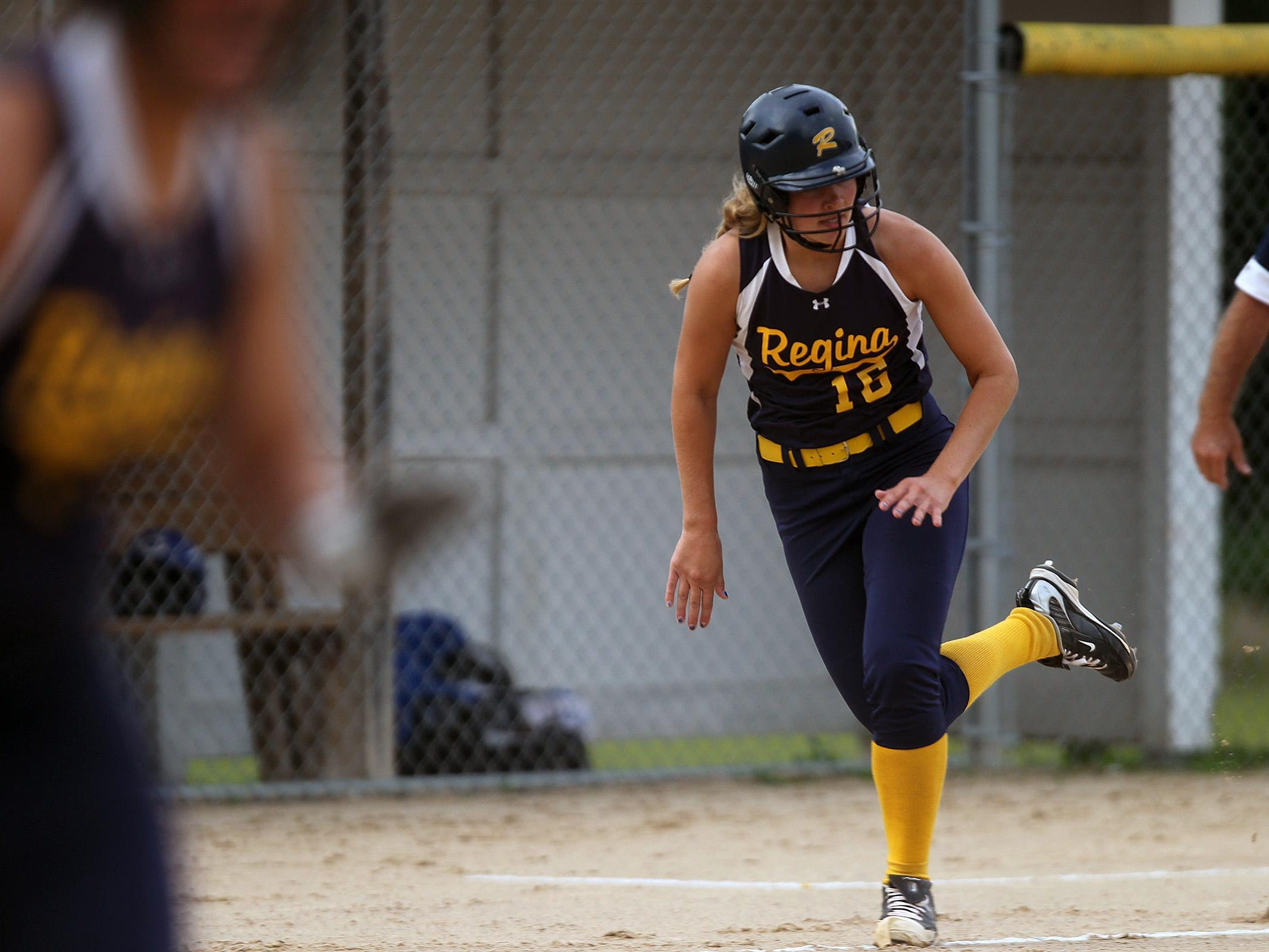 Regina's Sarah Lehman runs home during the Regals' game against Columbus on Wednesday, July 8, 2015. David Scrivner / Iowa City Press-Citizen