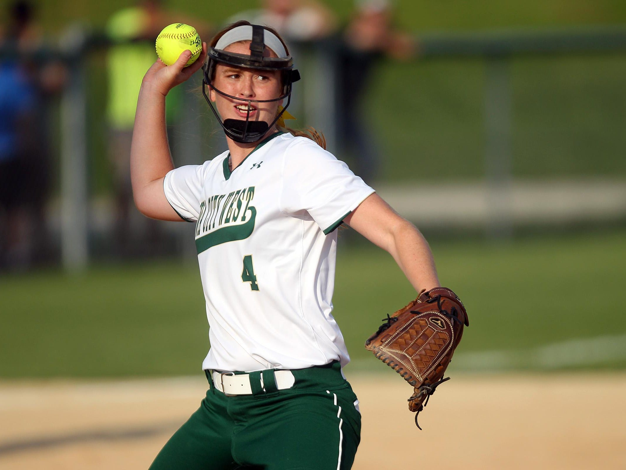 West High's Jessie Harder throws to first base during the Women of Troy's game against Linn-Mar on Thursday, July 9, 2015. David Scrivner / Iowa City Press-Citizen
