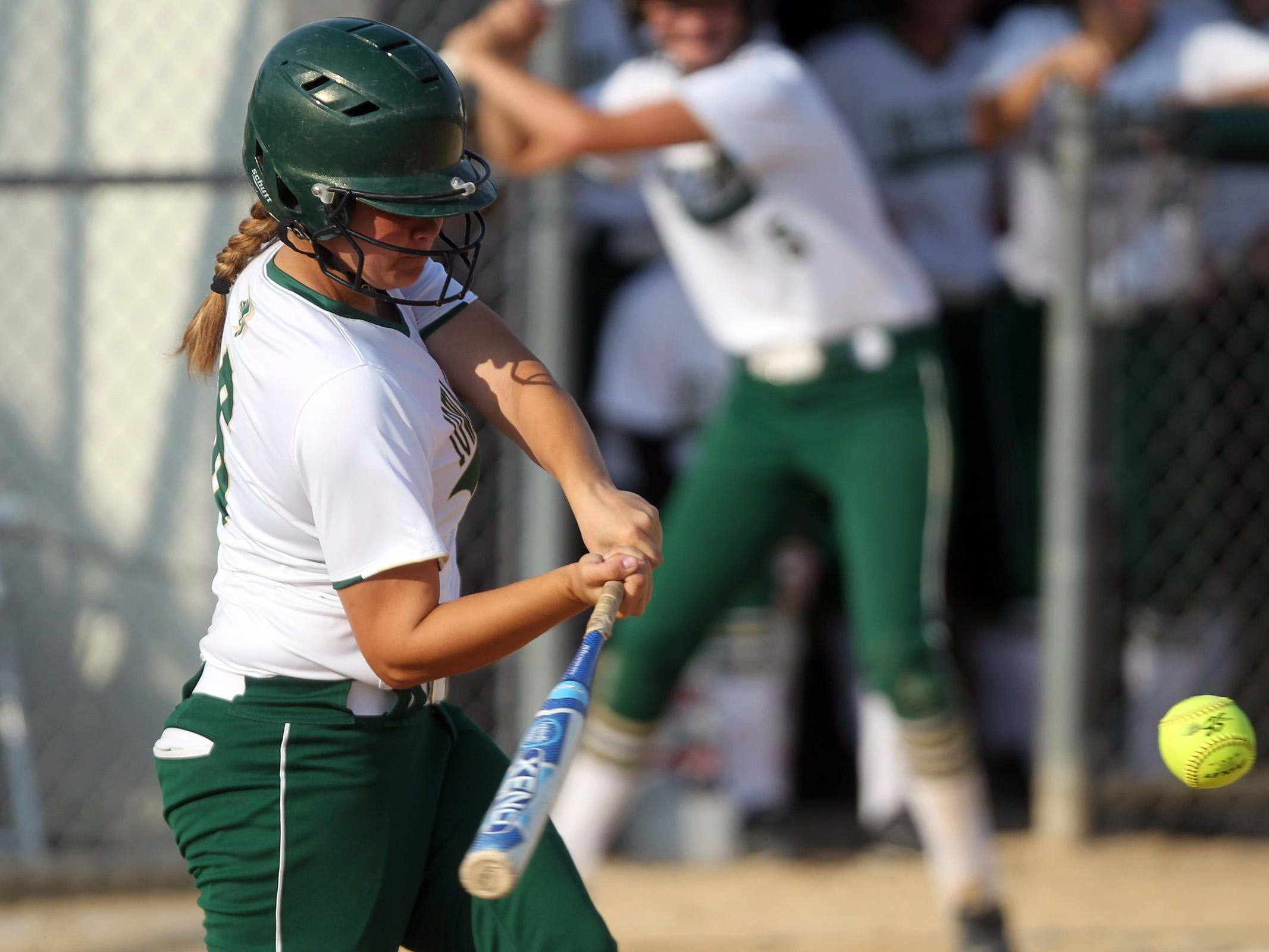 West High's Taylor Libby hits a home run during the Women of Troy's game against Linn-Mar on Thursday, July 9, 2015. David Scrivner / Iowa City Press-Citizen