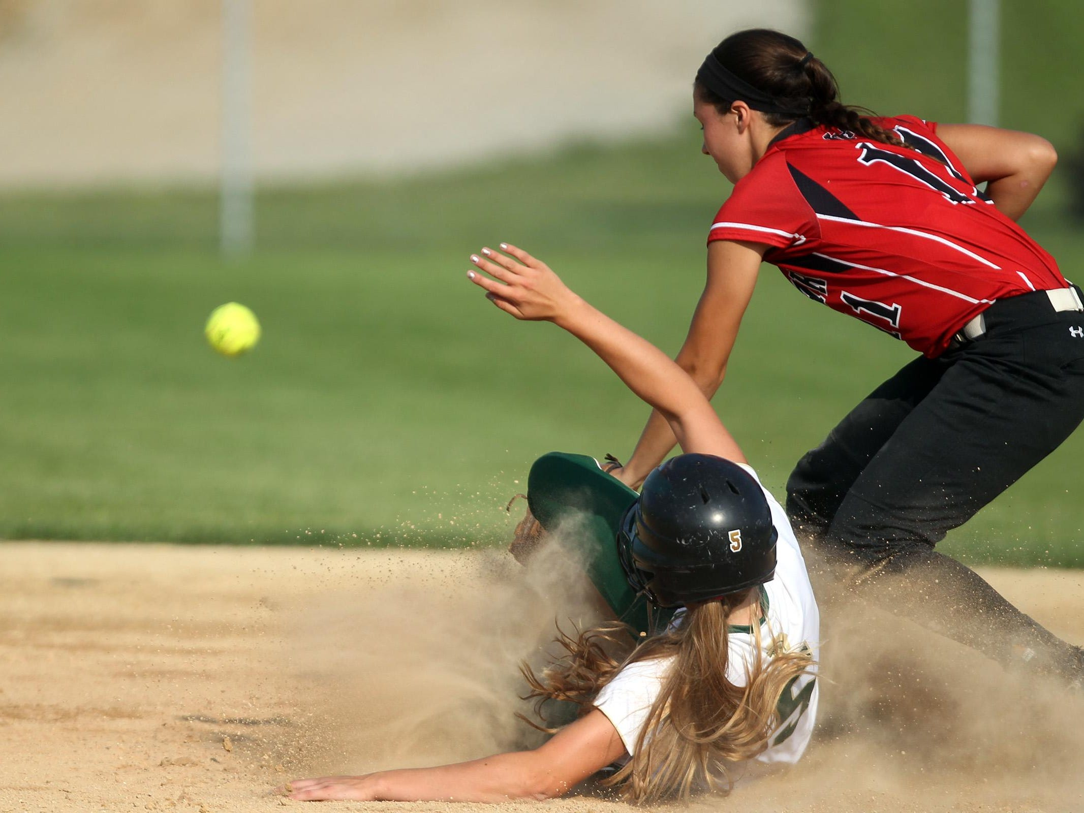 West High's Grace Tafolla safely slides to second base during the Women of Troy's game against Linn-Mar on Thursday, July 9, 2015. David Scrivner / Iowa City Press-Citizen