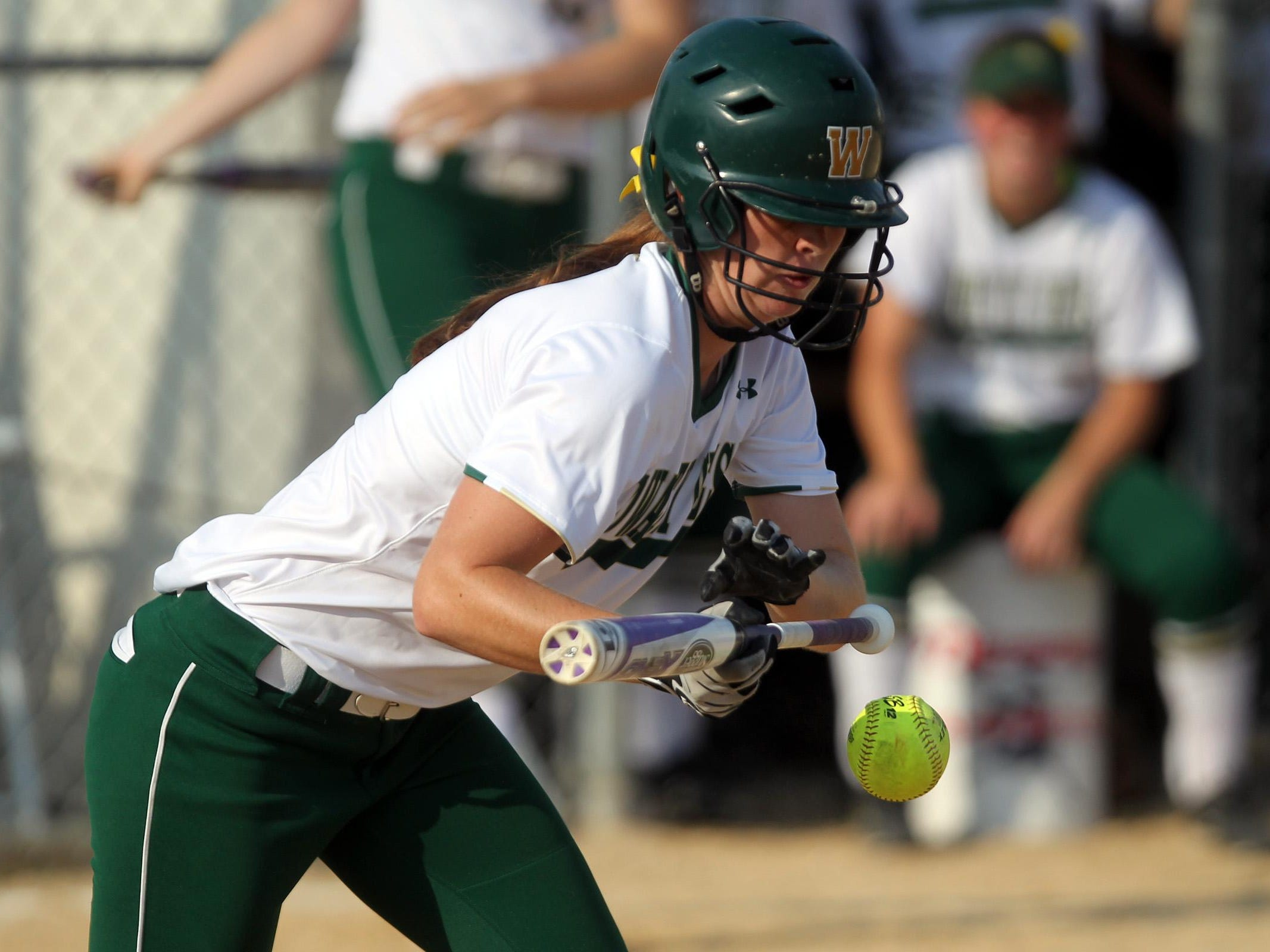 West High's Jessie Harder attempts to bunt during the Women of Troy's game against Linn-Mar on Thursday.
