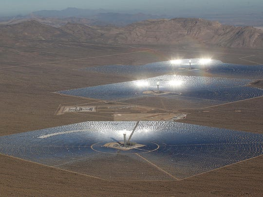 """Thousands of mirrors focus sunlight on boilers at the top of solar """"power towers"""" at Ivanpah on Oct. 21, 2014."""