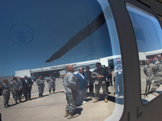 Gov. Terry Branstad checks out a Black Hawk helicopter during a tour of the 132nd Wing of the Iowa Air National Guard at the Des Moines airport on June 9. The airport and the Guard unit have been involved in a yearlong dispute over the unit's lease.