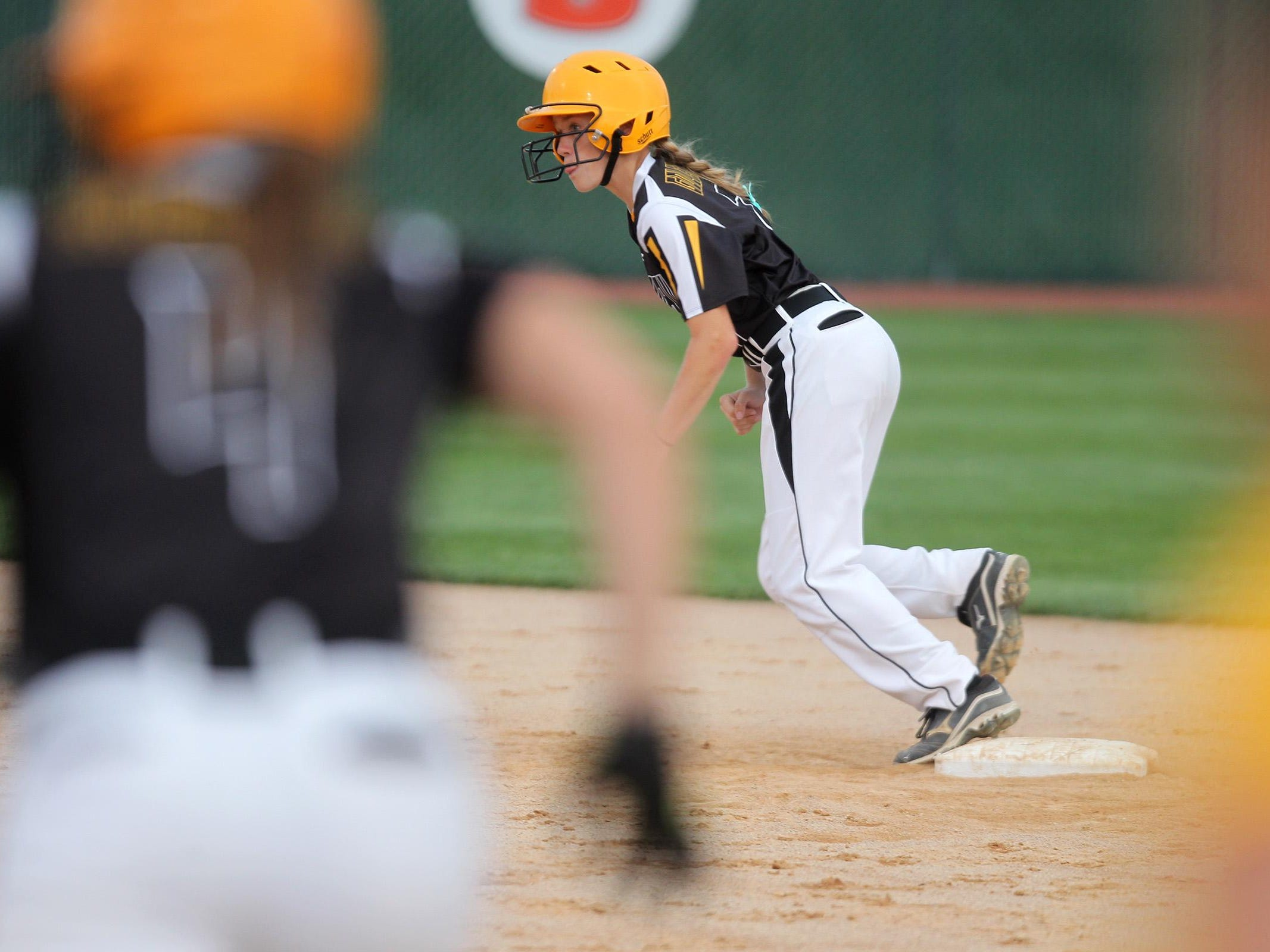 Mid-Prairie's Abby Tornow leads off second base during the Golden Hawks' regional game at Solon on Friday, July 10, 2015. David Scrivner / Iowa City Press-Citizen