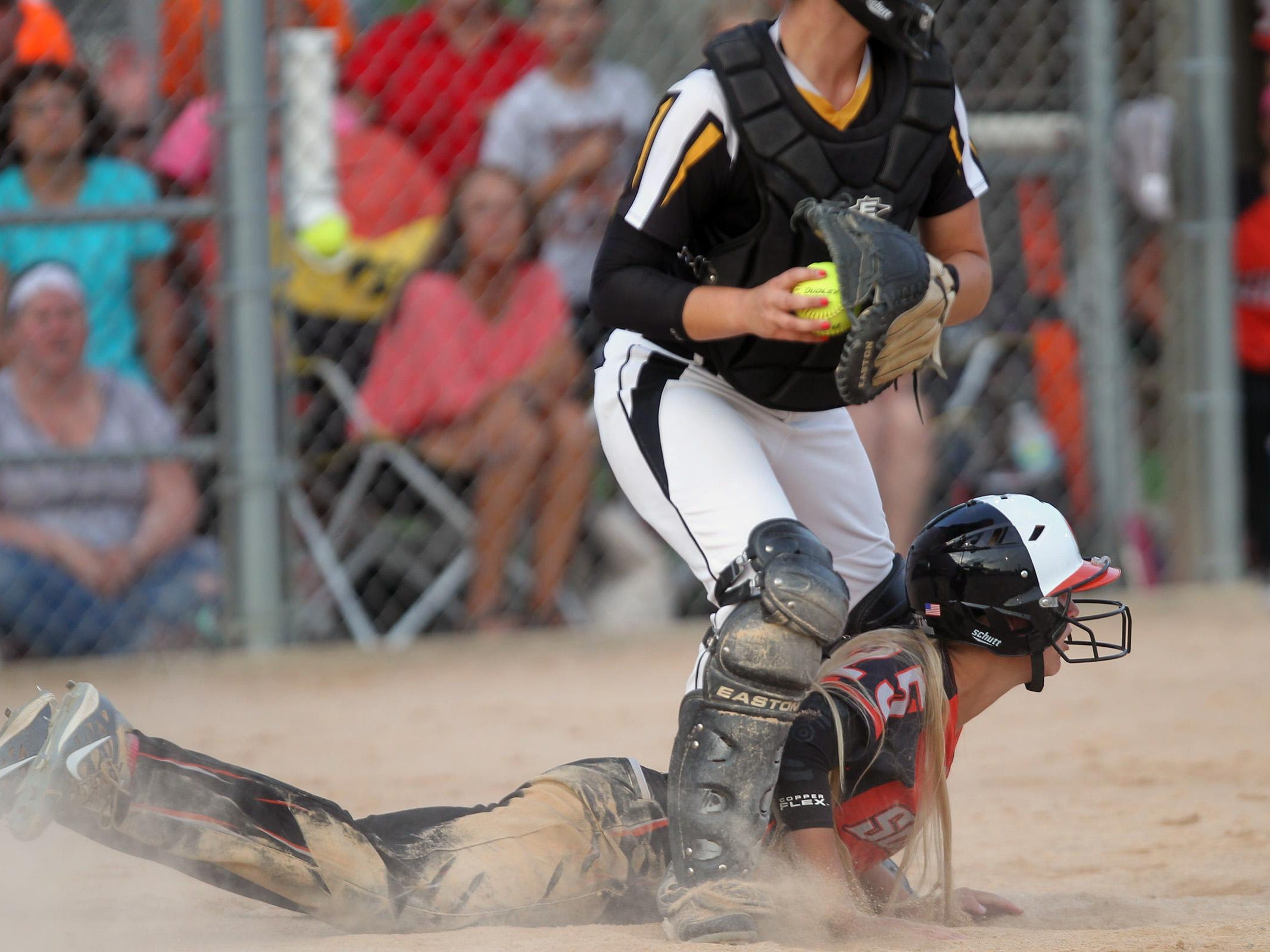 Solon's Nichole Oberthein lies on the ground after getting tagged out at home plate during the Spartans' regional game against Mid-Prairie at Solon on Friday, July 10, 2015. David Scrivner / Iowa City Press-Citizen