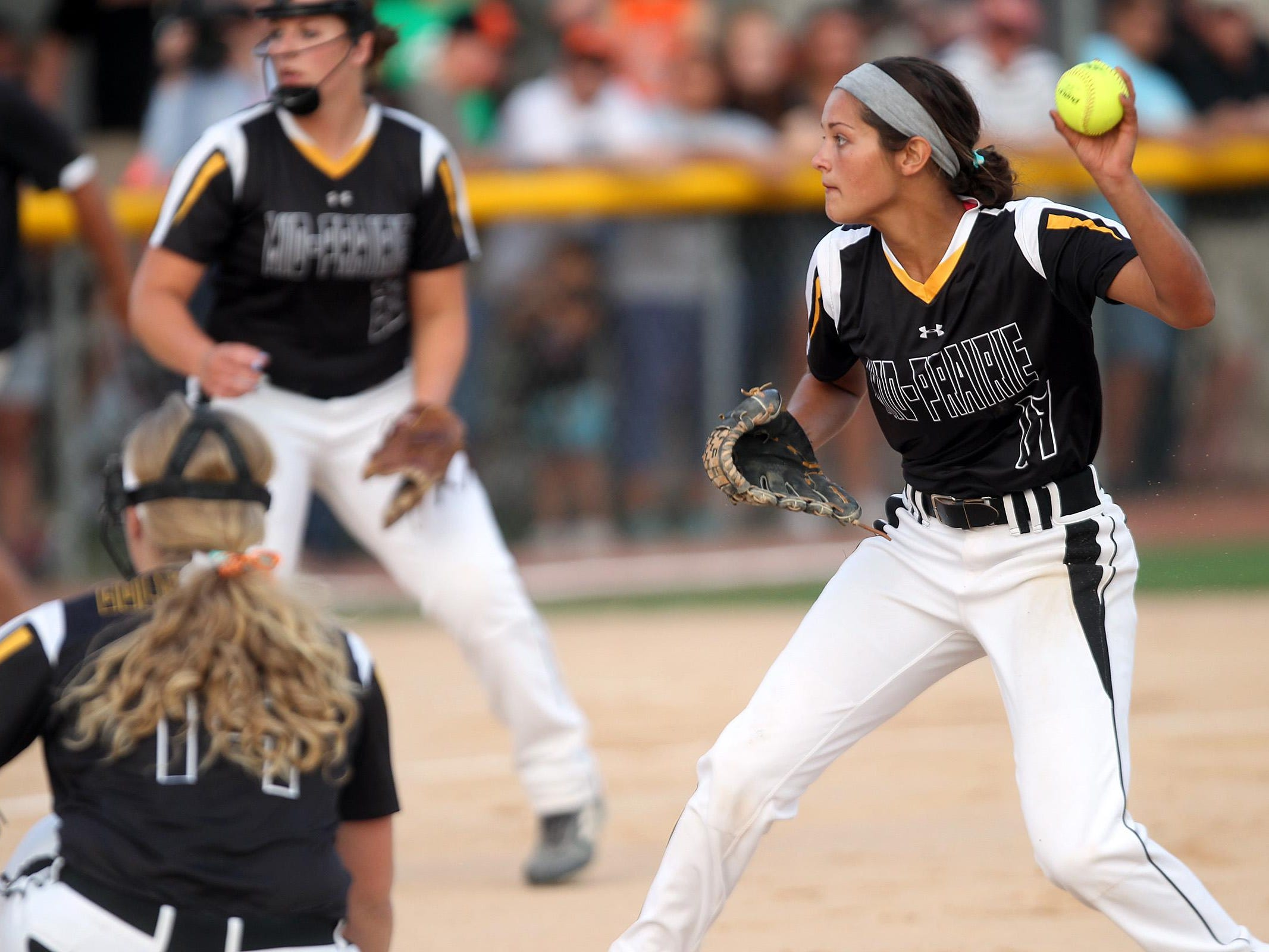 Mid-Prairie pitcher Emma Troyer throws to home plate during the Golden Hawks' regional game at Solon on Friday. Solon won, 12-2.