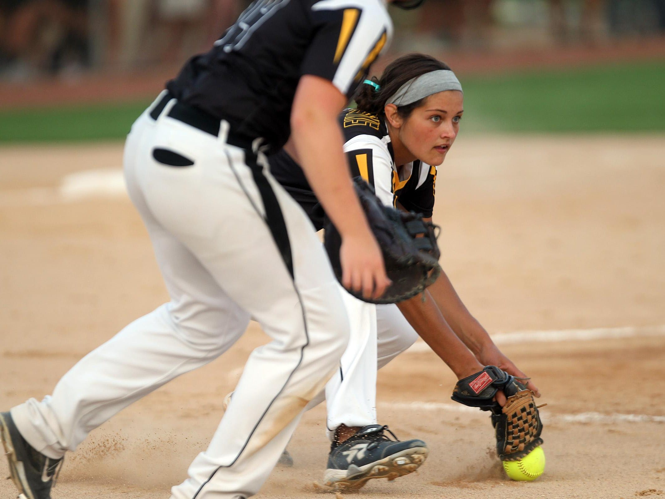 Mid-Prairie pitcher Emma Troyer tries to scoop up a bunt during the Golden Hawks' regional game at Solon on Friday, July 10, 2015. David Scrivner / Iowa City Press-Citizen