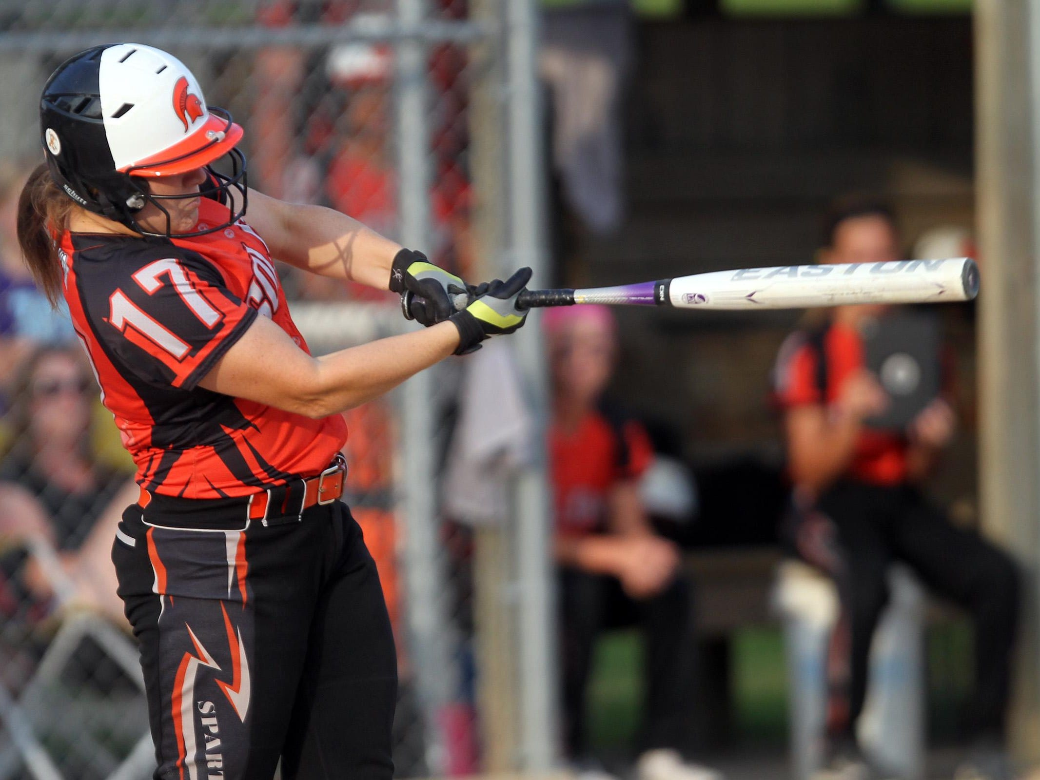 Solon's Monika Bevans takes a swing during the Spartans' regional game against Mid-Prairie at Solon on Friday, July 10, 2015. David Scrivner / Iowa City Press-Citizen