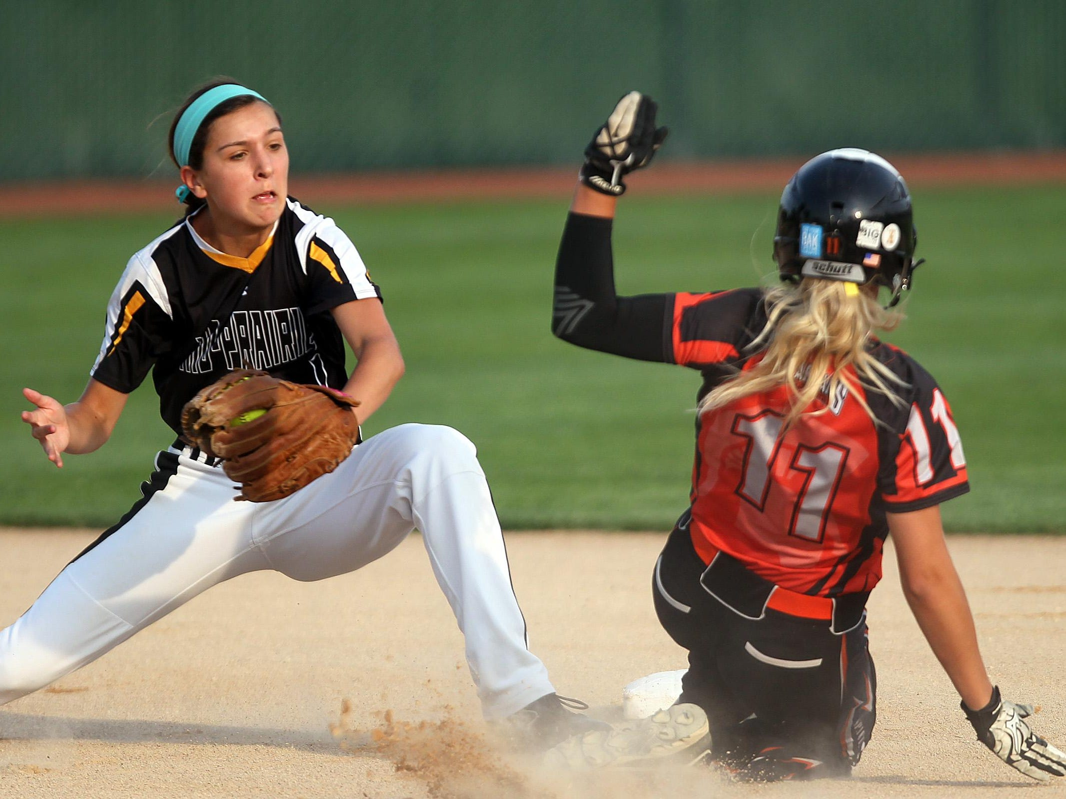 Mid-Prairie's Alex Rath tags out Solon's Emily Ira at second base during their regional game at Solon on Friday, July 10, 2015. David Scrivner / Iowa City Press-Citizen