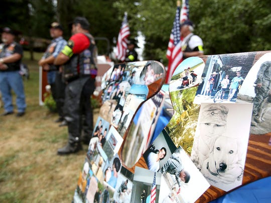 A collage of photos greets visitors during the dedication of a Fallen Hero Memorial Highway sign in memory of Army Cpl. Kory D. Wiens, 20, on Saturday, July 11, 2015.