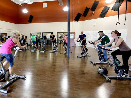 Participants cycle during the Pedal to the Finish: A Ride to End Cancer, a fundraiser for the American Cancer Society, at Epic Fitness in Salem on Saturday, July 11, 2015.