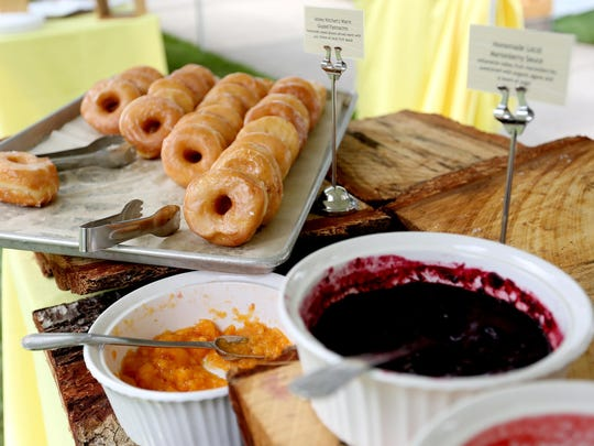 Glazed fastnacht doughnuts with fresh fruit sauce at the Mount Angel Abbey Saint Benedict Festival.