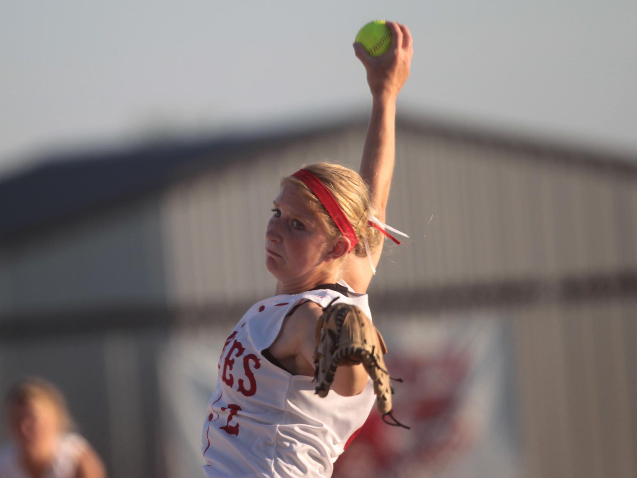 Highland's Katie Springer throws a pitch during the Huskies' game against West Branch in Riverside on Friday, July 12, 2013. David Scrivner / Iowa City Press-Citizen