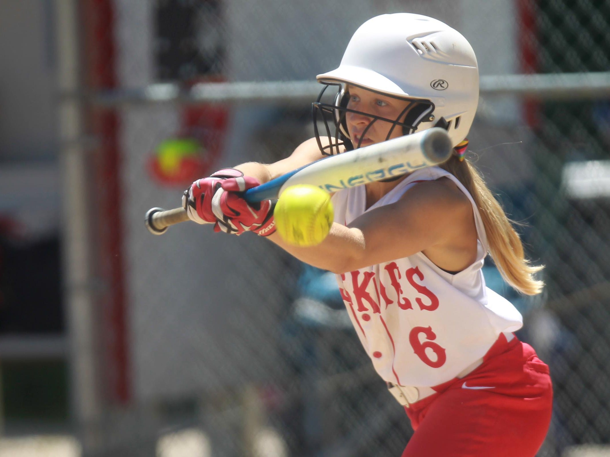 Highland's Kelsey Hora hits the ball during the Huskies' game against Waterloo East on Friday, June 20, 2014. David Scrivner / Iowa City Press-Citizen