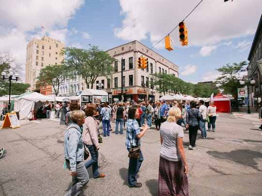 The weather can be steamy and sticky, but that doesn't keep crowds of people from exploring the work of artists from all across the country. This year's art fair in Ann Arbor runs through Saturday.