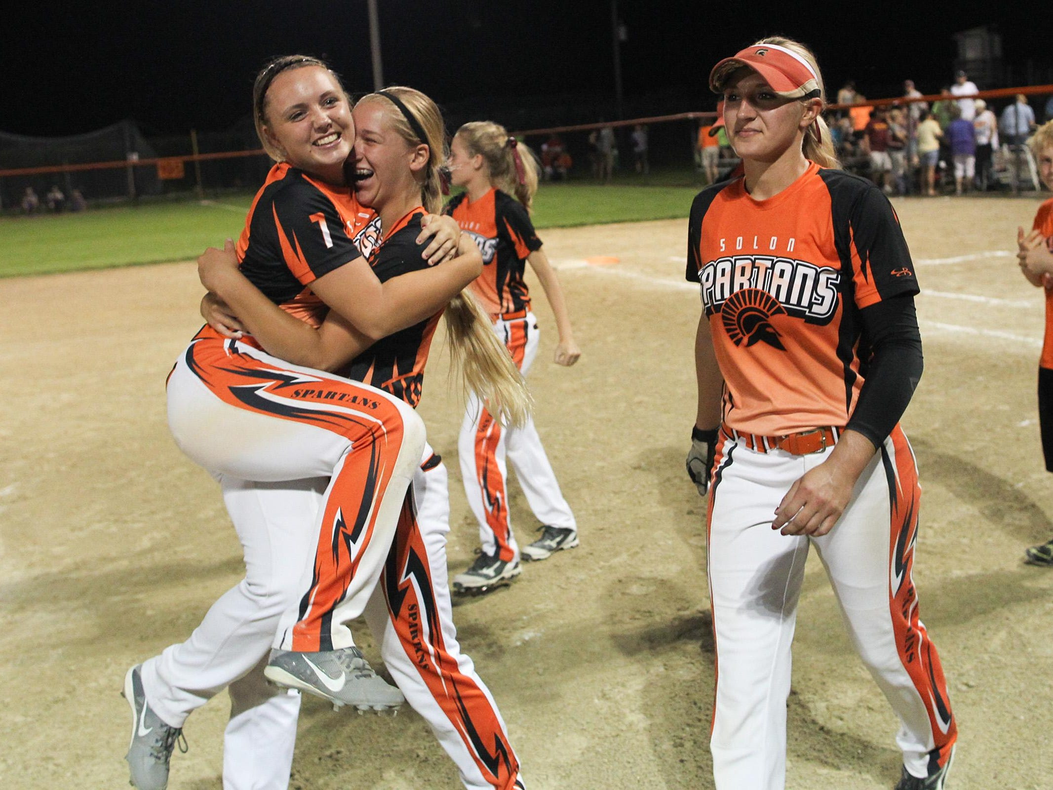 Solon's Nichole Oberthein picks up Hailey Denny for a hug following the Spartans' 5-1 Class 3A regional final win against PCM, Monroe in Grinnell on Monday.