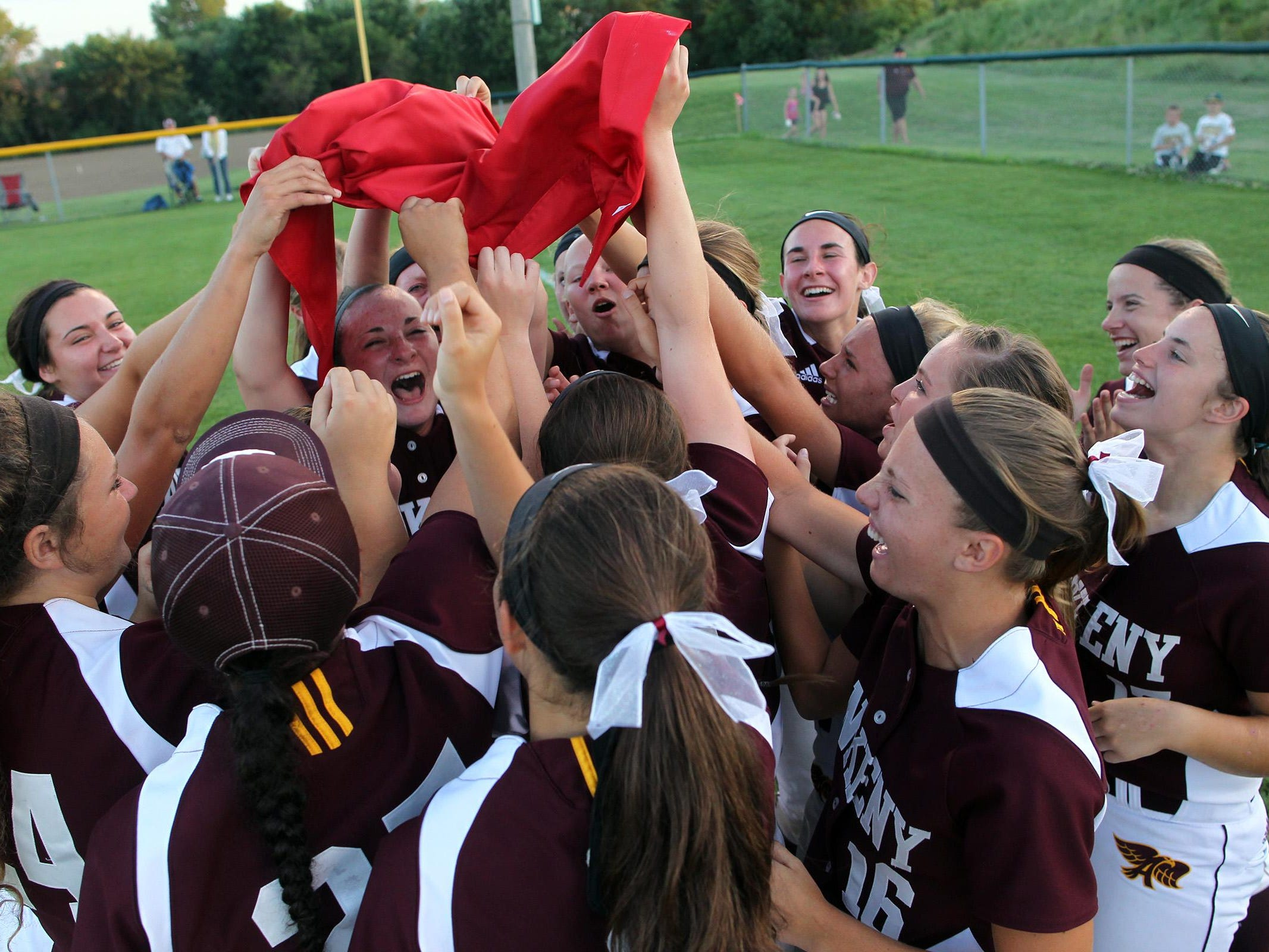 Ankeny teammates celebrate their Class 5A regional championship over West High on Tuesday, July 14, 2015. Ankeny won, 3-1, to head to state. David Scrivner / Iowa City Press-Citizen