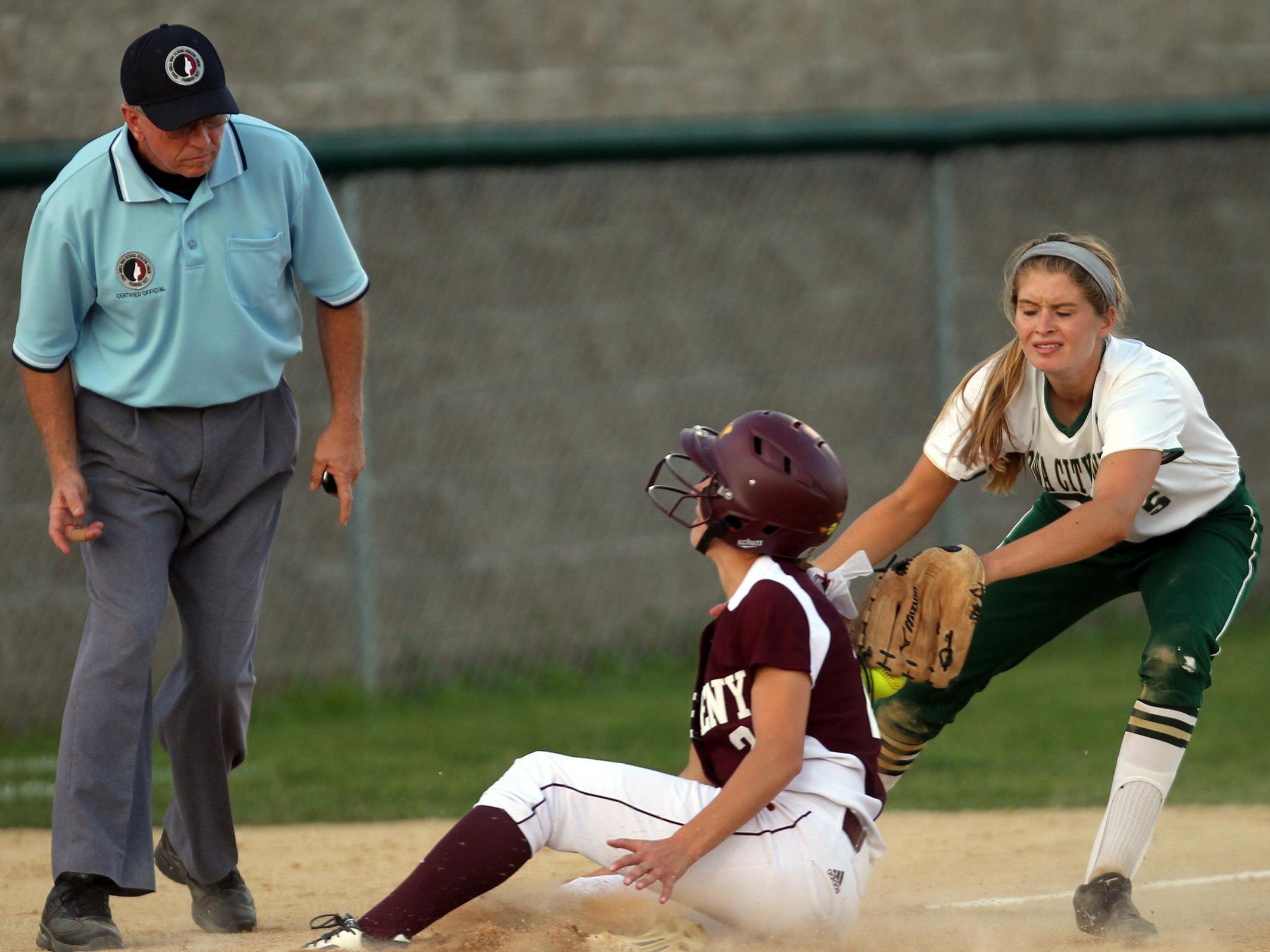 Ankeny's Melanie Rasmussen safely slides past West High's Grace Tafolla during their Class 5A regional championship game at West High on Tuesday, July 14, 2015. Ankeny won, 3-1, to head to state. David Scrivner / Iowa City Press-Citizen