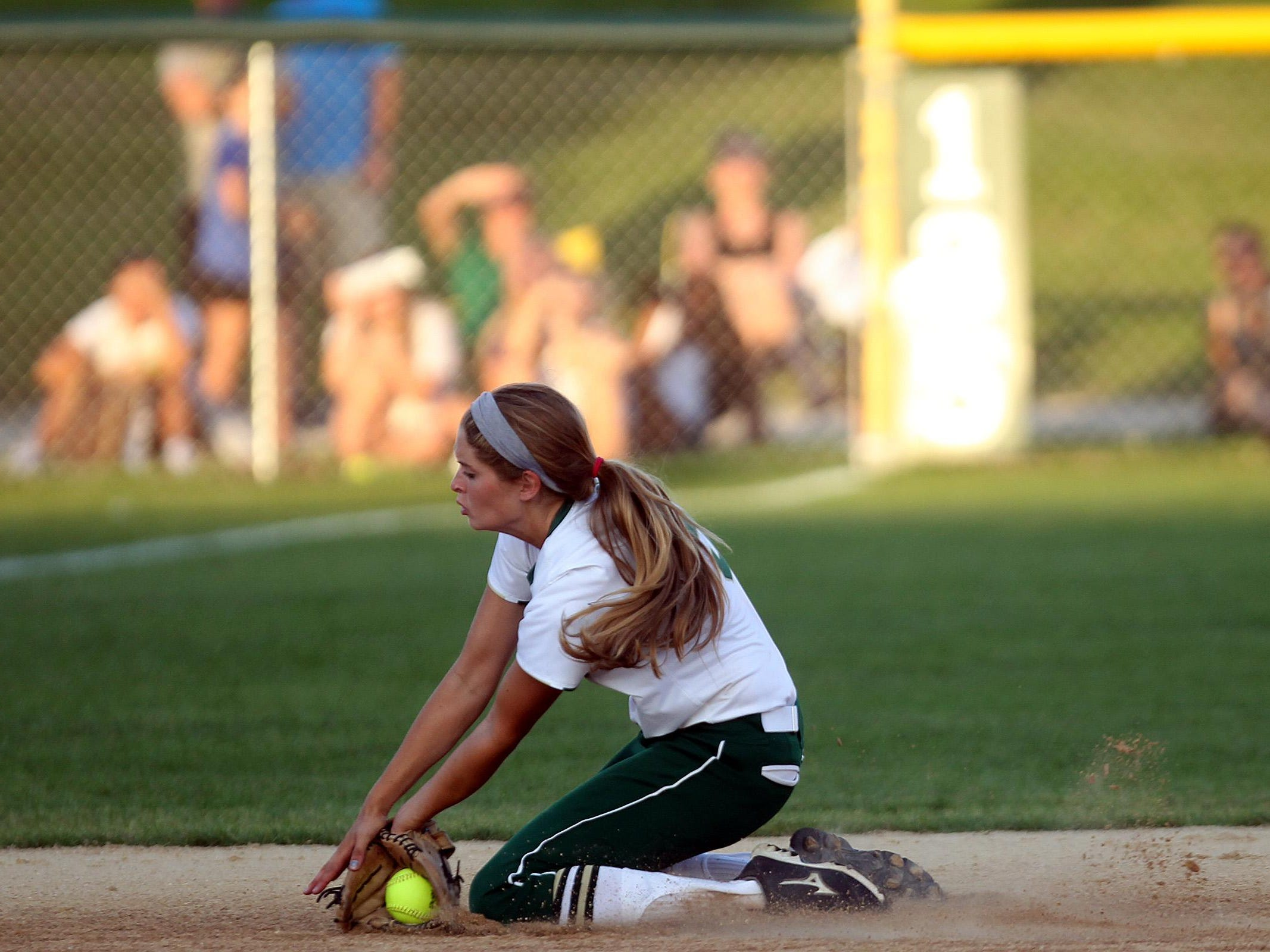 West High's Grace Tafolla stops a ground ball during the Women of Troy's Class 5A regional championship game against Ankeny at West High on Tuesday, July 14, 2015. Ankeny won, 3-1, to head to state. David Scrivner / Iowa City Press-Citizen