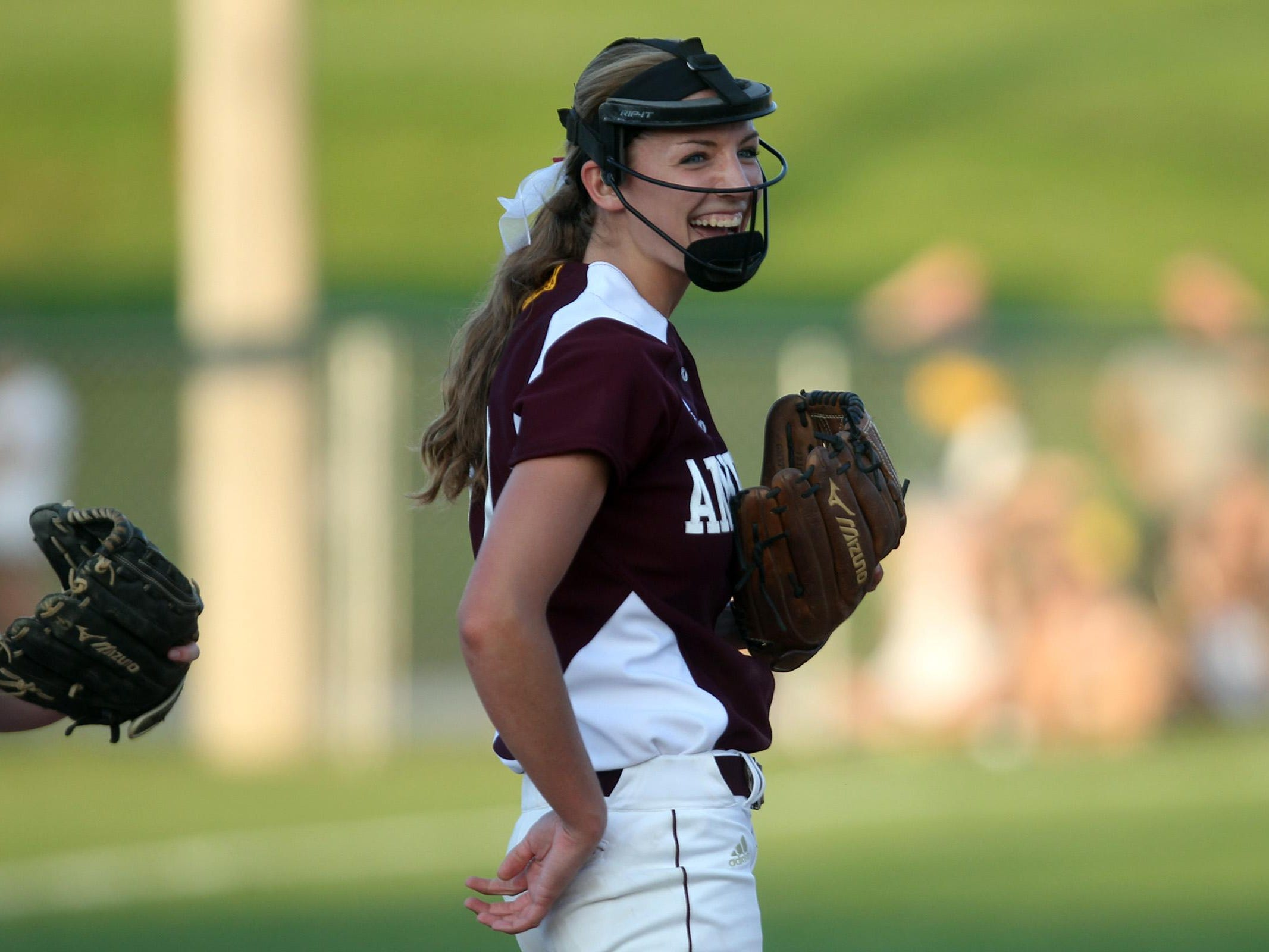 Ankeny pitcher Allison Doocy smiles after a strikeout during the Hawkettes' Class 5A regional championship game at West High on Tuesday, July 14, 2015. Ankeny won, 3-1, to head to state. David Scrivner / Iowa City Press-Citizen